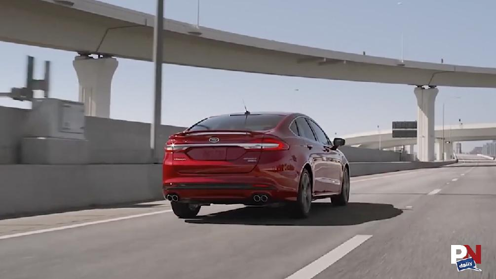 Why Ford Is Killing Sedans, Tesla Goes Through A Wall, Truckers Save A Life, Mustang Hybrid, And Cavalier Stunts