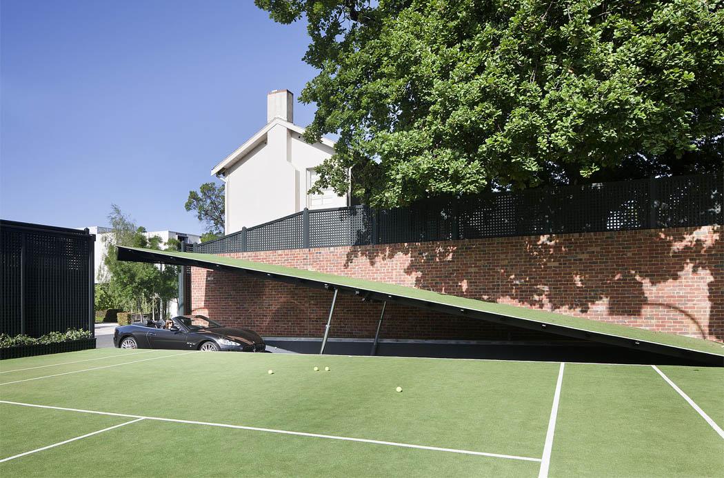 Hydraulic ramp access below tennis court to 'Batcave'
