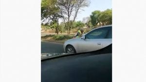 Woman Drives Off With Cop Clinging To Her Hood Trying To Avoid A Ticket