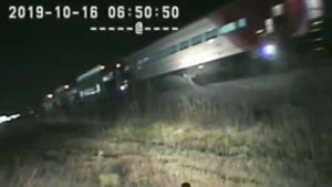 Trooper Drags Guy Out Of His Car Seconds Before It's Hit By A Train