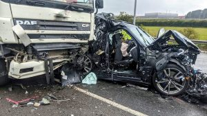 Miraculously, BMW Driver Survives After Being Crushed Between 2 Semis
