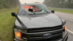F-150 Destroyed After Lightning Hits Highway, Sends Chunk Of Road Flying